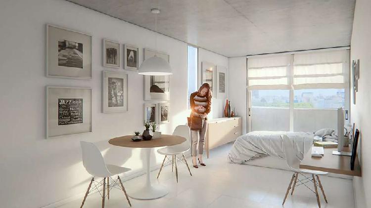 Monoambiente con balcon - patio de uso comun con pileta y