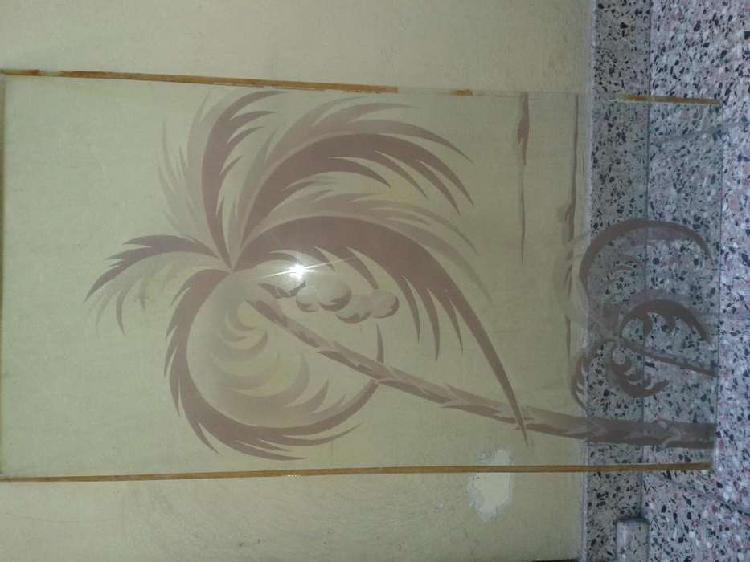 Antiguo vidrio decorado con palmeras